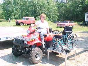 Picture of Mary, a wheelchair bound ATV user. This is the only way she can get out into the REAL outdoors.